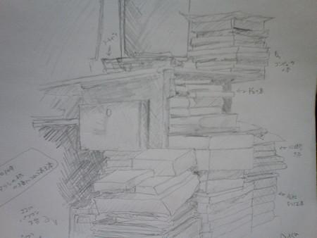20080109机の横の山積みの本